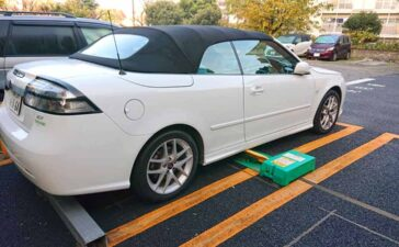 A Saab 9-3 Convertibl belonging to Mr. Ikuo who is neatly parked on one of the typical parking lots in Tokyo
