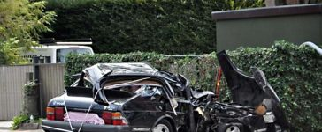 Classic Saab 900 with four young people Crashes into Light Pole