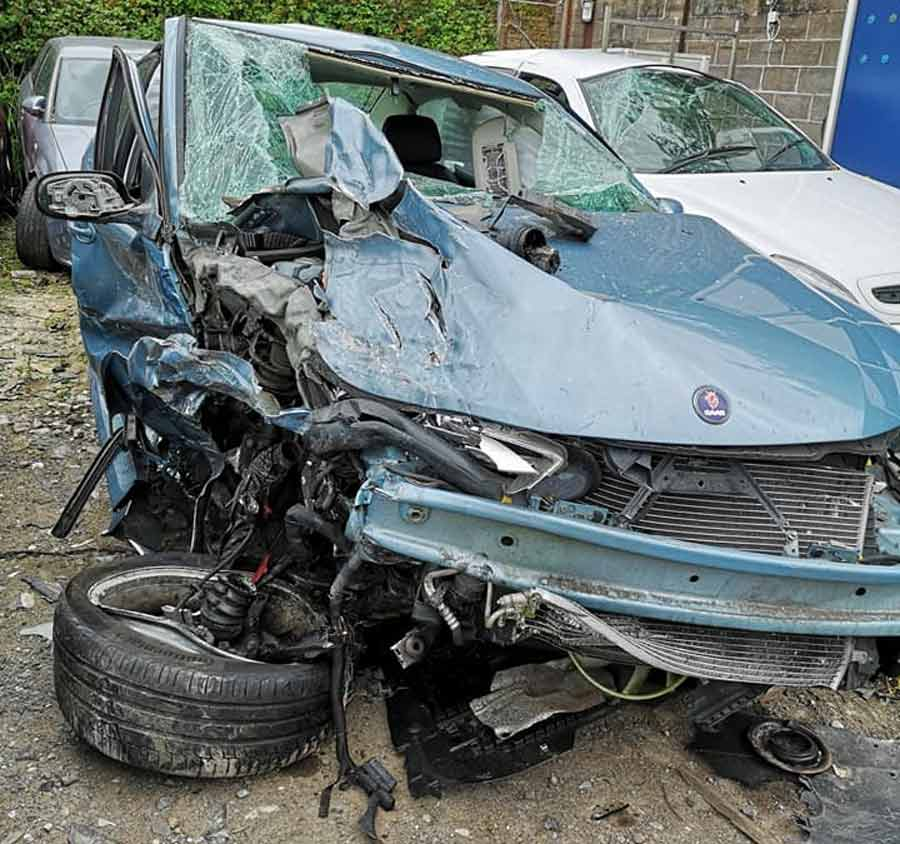 the remains of a saab car after a terrible collision