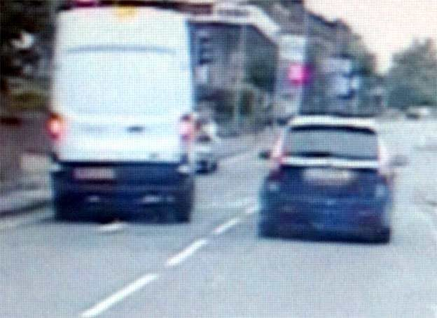 113mph: The Saab speeds through a set of Kearsley traffic lights in a bid to out
