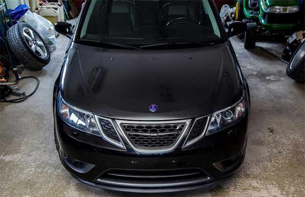 Great result - Carbon fiber vinyl wrapped hood of Saab Turbo X