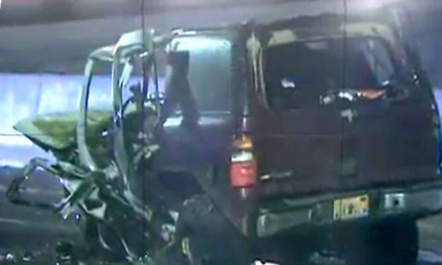 Destroyed Chevy Tahoe in Direct Crash with Saab 9-3