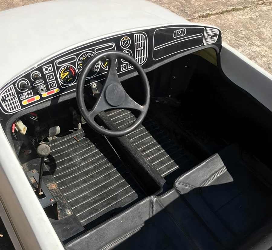 mini car simulates the classic Saab cockpit