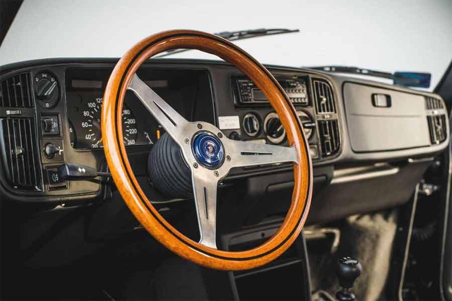 recognizable three-spoke Nardi steering wheel