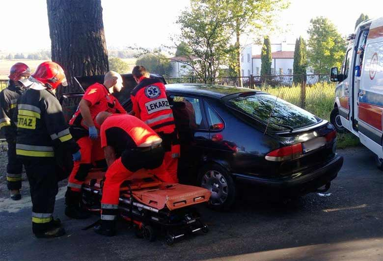 police help an injured driver