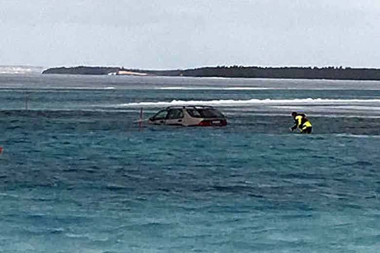 Firefighters Pull Driver from Submerged Saab 9-5