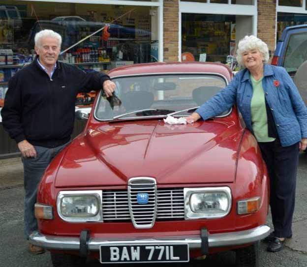 John Edwards and Doris Williams with a 1972 Saab 96 which his son bought at auction after Mr Edwards sold it as a new car in 1972