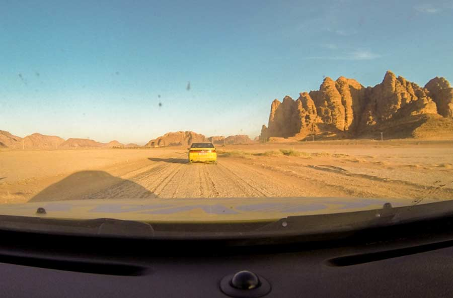 Saab 9000 cars in the middle of the desert