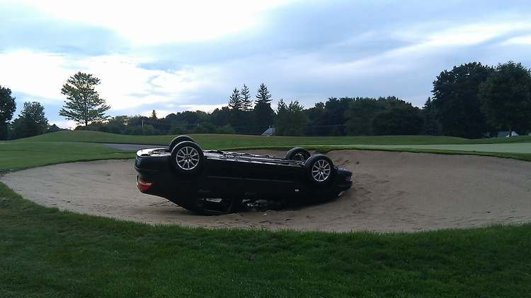 """Stolen"" Saab 9-3 flipped onto its roof, into a sand trap"