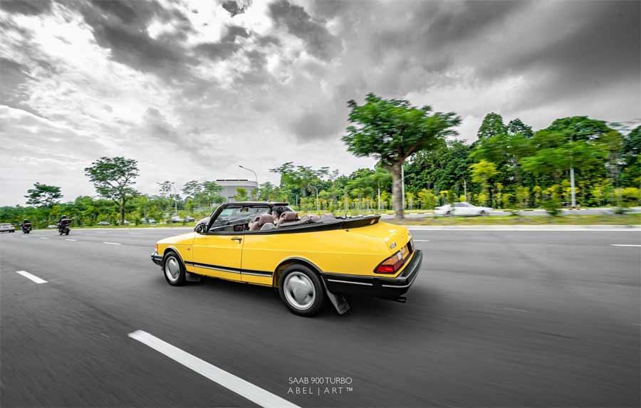 Yellow Saab 900